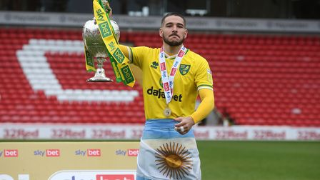 Emiliano Buendia of Norwich with the EFL Championship trophy at the end of the Sky Bet Championship