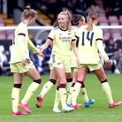 Arsenal's Vivianne Miedema (left) celebrates with her team-mates after scoring their side's sixth go