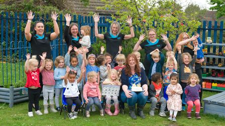 Pirton Pre-School staff with children as the setting celebrates its tenth anniversary