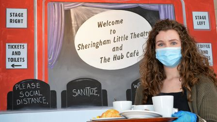 Katie Thompson serving meals in the Hub at Sheringham Little Theatre