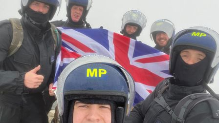 The moment the officers reached Mt Snowdon's summit.
