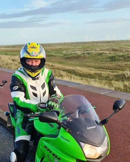 Bill Griffin with his treasured Kawasaki which has been badly damaged as a result of the RTC
