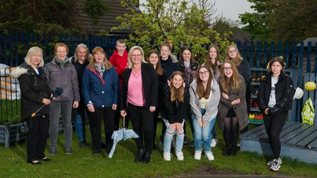 Now young adults, former Pirton Pre-School children pose with staff to commemorate 10 years of the setting's permanent home