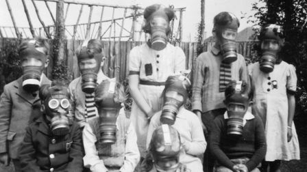 A group of school children undergo an gas mask drill in 1941.