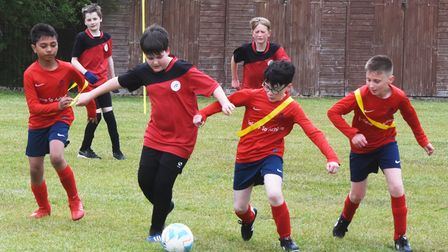 Action from the North Suffolk Schools ALT Year 6 Boys Football Championships. Grove vs Red Oak.