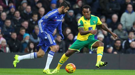 Diego Costa of Chelsea and Andre Wisdom of Norwich in action during the Barclays Premier League matc