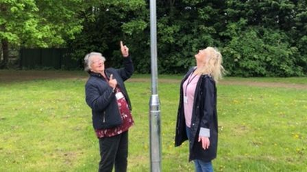Cllr Jean Matheson (left) andCllr Kathy Bishop( right) with the new solar light.