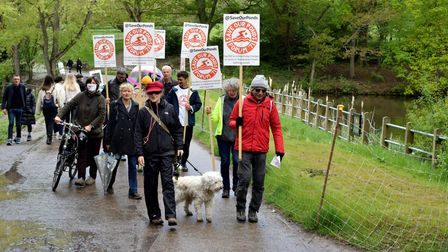 Intrepid protesters on May 16 walk between the Mixed Pond and the Men's Pond on Hampstead Heath