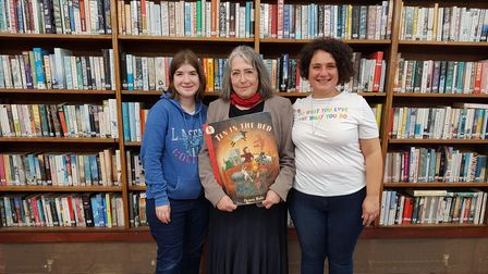 Myra (centre) at Belsize library with Jessica and Maria -holding a book from one of her Rhyme Times sessions