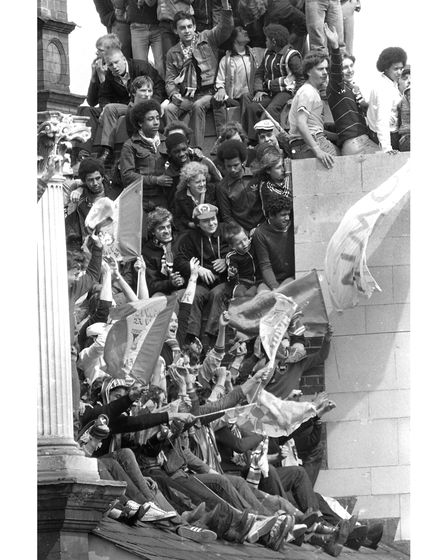 Supporters on the roof of Burton's shop on Ipswich Cornhill during the UEFA Cup winning celebrations in 1981.