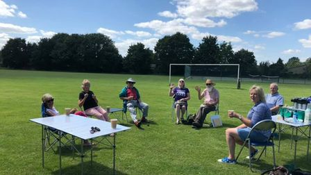 Villagers of Houghton and Wyton basking in the sunshine in July 2020 in an outdoor coffee morning.
