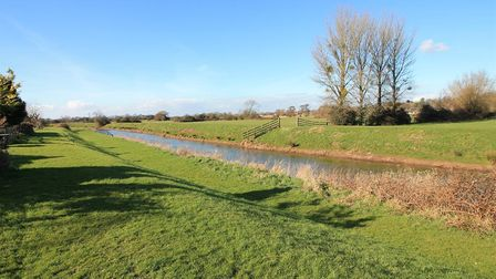 Green field behind the property in Station Road, Congresbury, with stream running through it