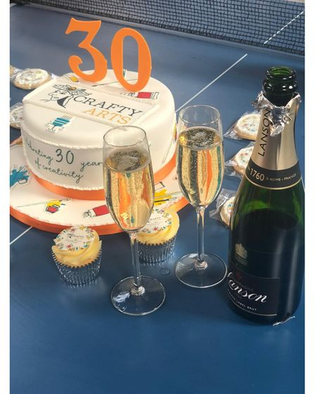 Crafty Arts cake and champagne