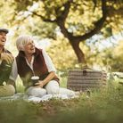 Elderly couple sat outside after receiving glaucoma treatment from London Ophthalmology Centre