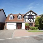 Exterior of half-timbered-effect executive house in Bramley Close, Sandford with attached garage and drive