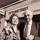 Betty and Nevile Robinson outside the business in Frognal Parade, Finchley Road