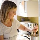 Hannah of Home County Candle Co in her kitchen preparing another batch of candles