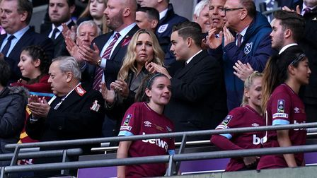 Jack Sullivan (centre) managing director of West Ham United Women appaluds the players with father,