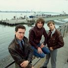 Andy McCluskey, Malcolm Holmes andPaul Humphreys ofOrchestral Manoeuvres in the Dark on Liverpool's waterfront in1982