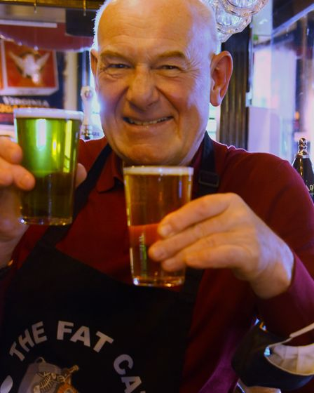 The Fat Cat landlord, Colin Keatley, with his special beer, Yeller 'N' Green, to celebrate NCFC winn