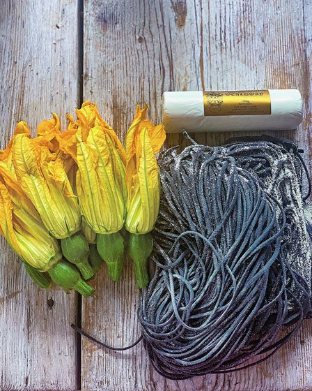 Courgette flowers on black pasta made with ingredients from West Hampstead farmers market