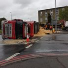 Lorry overturned in Redbridge near Charlie Browns Roundabout.