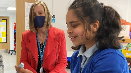 Linda Scase-Jones, chair of governors at The Clare School, with pupil in new classroom.