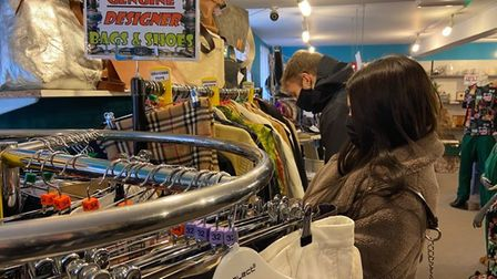 Shoppers browsing the designer clothing rail at PACT Animal Sanctuary