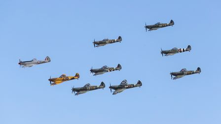 A mass Spitfire flypast at the Duxford Battle of Britain Airshow 2019 .
