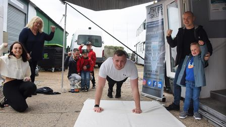 PC Luke Hall starting his challenge of 2,222 push ups in 22 hours to raise money for the Ipswich Bus