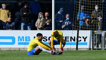 Dejection for Ben Wynter of Torquay United and Joe Lewis of Torquay United after the final whistle