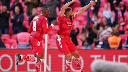 Hornchurch's Ellis Brown (right) celebrates scoring their third goal of the Buildbase FA Trophy Fina