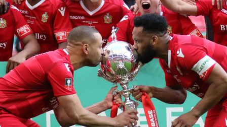 Rickie Hayles of Hornchurch and Lewwis Spence of Hornchurch kiss the FA Trophy during Hereford FC vs
