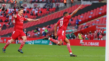 Ellis Brown celebrates scoring Hornchurch's third goal in the FA Trophy final at Wembley