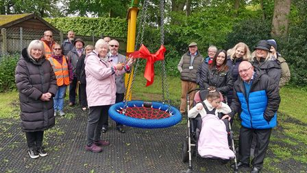 Suzanne Jones, centre, cut a ribbon to officially open the new swing at theAnnes Gardner King playground in Wroxham.