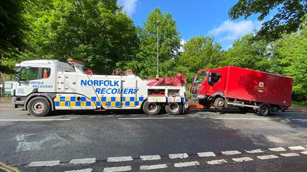 A Royal Mail lorry crashed through a wall in Rosary Road, Norwich, on Monday morning.