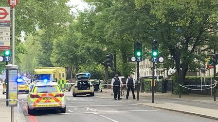 A cyclist was taken to hospital after a collision in City Road, with a police car responding to an emergency