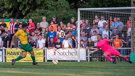 Hitchin Town in action against Luton in 2018