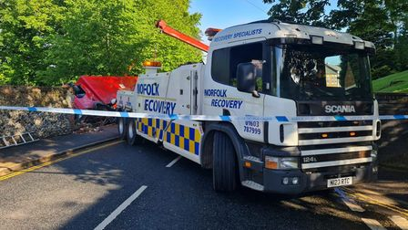 A recovery vehicle pulls the lorry from the park.