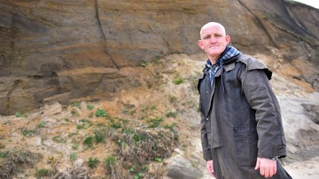 Kevin Murphy, Norfolk Wildlife Rescue, at Bacton cliffs where netting has been put in place which wi