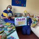 CHSW staff with books from Beansprouts Childcare