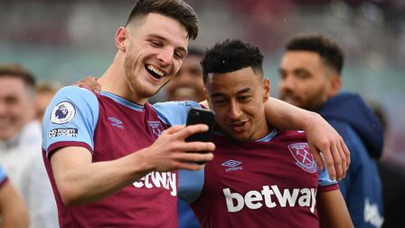 West Ham United's Declan Rice (left) and Jesse Lingard during a lap of appreciation at the end of th