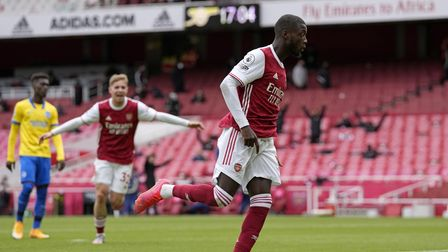 Arsenal's Nicolas Pepe celebrates scoring their side's first goal of the game during the Premier Lea