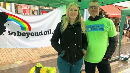Market organiser and Sustainable St Albans volunteer Craig Scudder at the Greenpeace stall with Greenpeace volunteer.