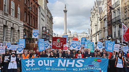 Demonstrators attend a rally in central London, in support of the NHS. Photograph: Victoria Jones/PA