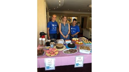 Volunteers at charity fete stall