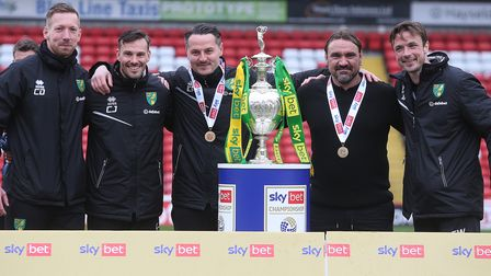Norwich head coach Daniel Farke and his coaching team savour the Championship title at Barnsley