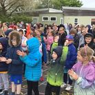Cheers, applause and joyfrom pupils at Reydon Primary School at the unveiling of anew all-weather running track.