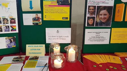 St Albans Cathedral stall candles from Amnesty.