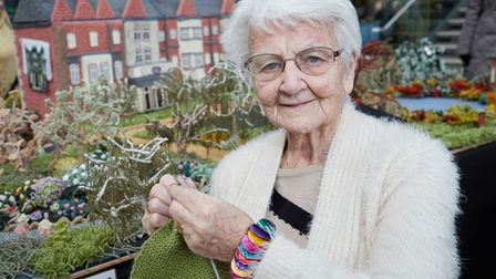Margaret Seaman with her knitted recreation of Sandringham.